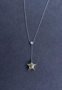 Tiffany & Co. Platinum Yellow Sapphire Star and Diamond pendant necklace