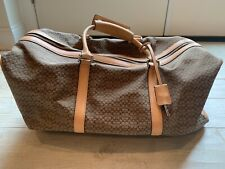 coach duffel,21x10x12,beige, good condition with few marks on leather/handles.