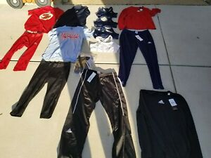 Lot of 14 Adidas Shirts, Shorts,Pants, Compressions Size medium, Large.New, used