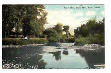 SD - BLACK HILLS SOUTH DAKOTA Postcard RAPID RIVER BOYS/MEN SITTING ON THE BANK