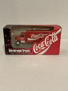 1/64 scale ERTL Coca-Cola Beverage Truck Opening Rear Doors Rubber Tires. NIB