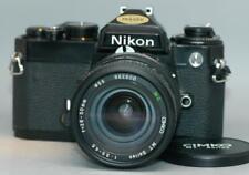 Nikon FE Black 35mm film camera with 28-50mm zoom lens - tested & works - Ex.!