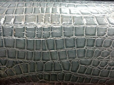 Gray crocodile design vynil. Sold by the yard.