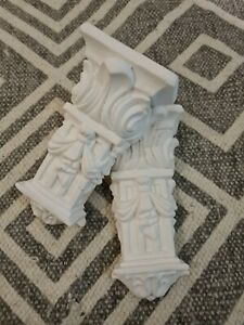 A pair of beautiful small plaster corbels