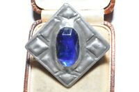 VINTAGE PEWTER BROOCH WITH A CENTRAL BLUE GLASS STONE & ORNATE DESIGN