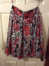 John Rocha size 12 flared low waist, multicolored red,black,white drindle skirt