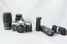 Olympus OM2n film camera including 2 lenses, Winder 2 and a carry bag