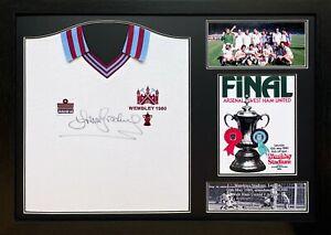 FRAMED SIR TREVOR BROOKING SIGNED WEST HAM UNITED 1980 FA CUP SHIRT & PROOF COA