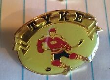Tyke hockey player lapel pin pre-owned