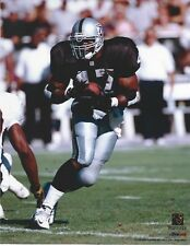 TYRONE WHEATLY OAKLAND RAIDERS 8 X 10 PHOTO WITH ULTRA PRO TOPLOADER