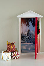 Opening Christmas elf door with North Pole image and miniature presents