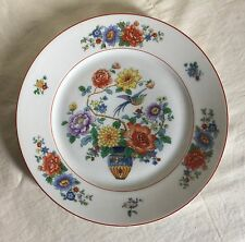 """KPM luncheon plate, floral motif with bird, vase and red trim. 9"""" d. Early 1900."""