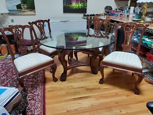 54 Inch Round Glass Top Table With Ornate Carved Wood Base and Four Chairs