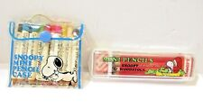 VINTAGE SNOOPY PENCIL SET AND SHARPENER LOT OF TWO DIFFERENT IN CASES JAPAN