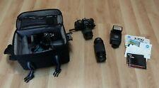 Minolta X-700 35mm Slr Film Camera, 2 lenses, flash, manuals, and soft case.