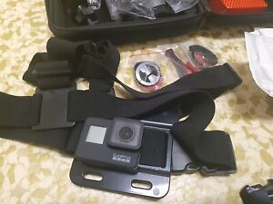 GoPro Hero 7 Black with many accessories near new condition