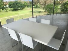 Dining table and 6 white leather chairs