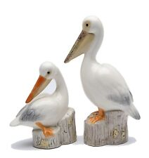 "Pair of  Pelicans Salt and Pepper Shaker tall  4.5"" tall sitting 3"""