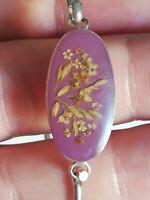 Bracelet rigide en argent massif et  des fleurs naturelles en résine