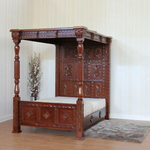 Ancestral style Carved Four Poster Bed with full headboard and top canopy,