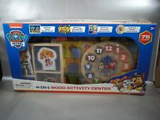 NIB PAW PATROL 4 IN 1 ACTIVITY CENTER 4 ACTIVITIES CLOCK ABC DRESS UP & PUZZLE