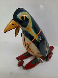 T.M Japan Chromo Lithographed Tin Skiing Penguin Toy Japan Japanese Marx Vintage