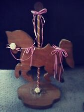Wooden horse with two pink lamps, in excellent used condition.