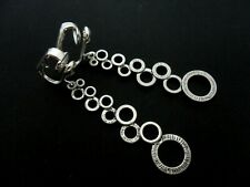 A PAIR LONG DANGLY TIBETAN SILVER CIRCLES THEMED CLIP ON EARRINGS. NEW.