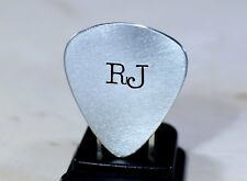 Guitar pick with personalized initials in aluminum