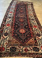 AN AWESOME ANTIQUE RUG