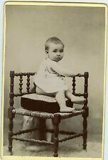 PHOTO Cabinet Batna Algérie Boutellier un bébé prend la pose sur un coussin 1890