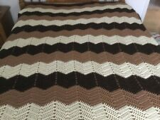 Afghan.  5ft. x6ft.  Two shades of brown and white.
