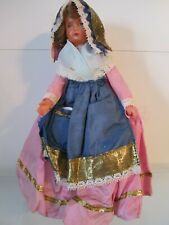 CELLULOID DOLL FROM FRANCE WITH A COIN IN HER POCKET
