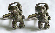 A VINTAGE PAIR OF T-BAR CUFFLINKS WITH A PEWTER TEDDY BEAR IN ROLLER SKATES