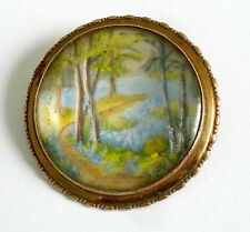 A VINTAGE TLM, THOMAS L MOTT BROOCH WITH A LAKESIDE SCENE
