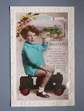 R&L Postcard: Birthday Greetings Embossed, Girl on Toy Model Train