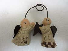 Angels, by Sarah's Attic holding a star w/heart wings ornament