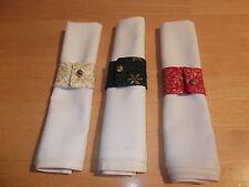 Set di 4 Portatovaglioli ad anello in un rosso, verde o oro tessuto di Natale.
