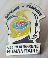 PIN'S SAPEURS POMPIERS CASQUE CLERMAUVERGNE HUMANITAIRE