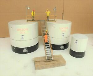 3 CUSTOM BUILT STORAGE TANKS and a LADDER SYSTEM with (3) FIGURES