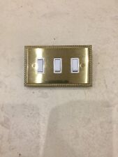3 GANG - GEORGIAN STYLE BRASS  GRID SWITCH WHITE INSERTS CRABTREE