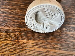 Antique wooden butter stamp intricately carved bird
