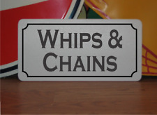 Whips and Chains Metal Sign
