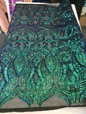 GREEN  ROYALTY IRIDESCENT SEQUINS ON A 4 WAY STRETCH NUDE MESH-SOLD BY YARD.