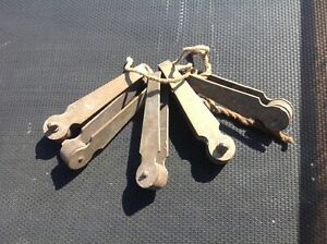 """5 X OLD VINTAGE BRASS CURTAIN HOOK RUNNERS WITH WOODEN WHEELS  3"""" LONG"""