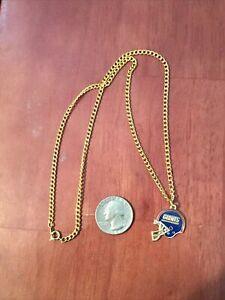 New York Giants Helmet Team Logo Pendant With Gold tone necklace.