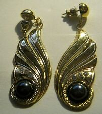 Wonderful gold tone metal dangle style earrings with white & black stones