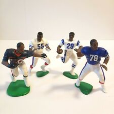 Lot of 4 - Vintage starting lineup NFL action figures #29, #30, #55, #78
