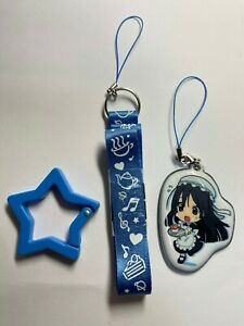 Cell phone strap with cute girl dressed maid costume mascot from Akiba Japan