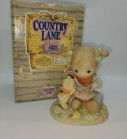 Enesco Precious Moments Country Lane Figurine Peas Pass the Carrots (1997)